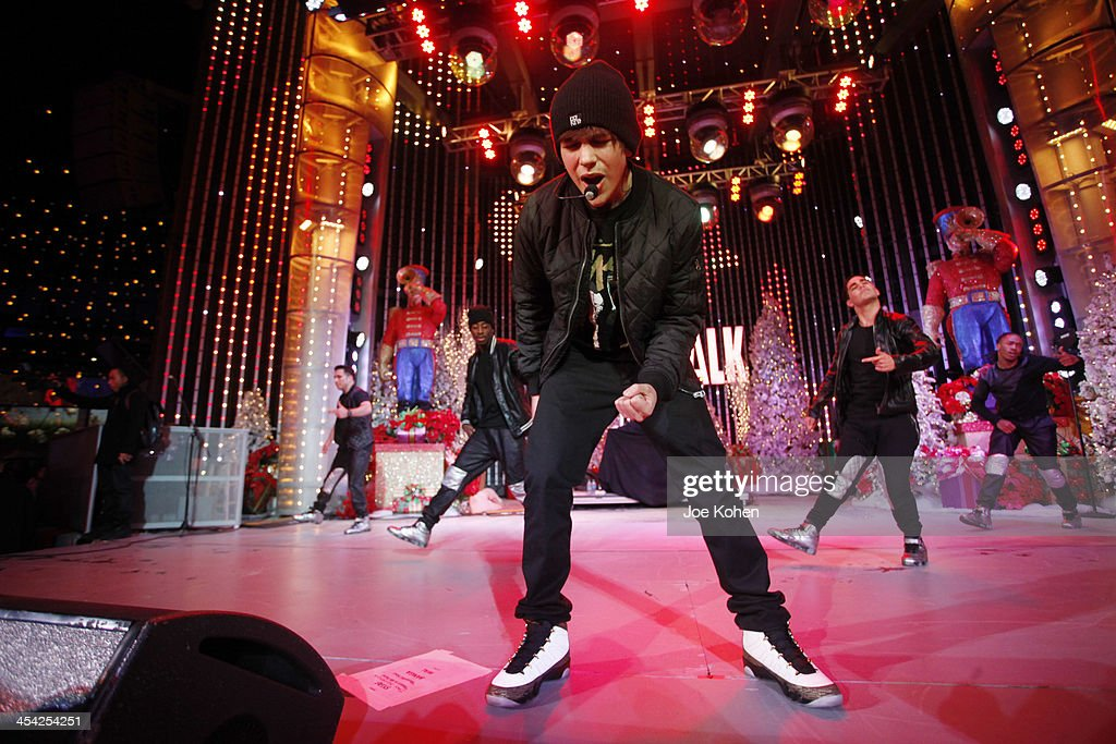 Singer Austin Mahone performs live on stage during The Salvation Army's 4th Annual Rock The Red Kettle Concert at 5 Towers Outdoor Concert Arena on December 7, 2013 in Universal City, California.