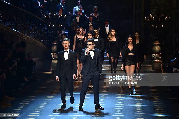 Singer Austin Mahone performs next to Cameron Dallas during the show for fashion house Dolce Gabbana during the Men's FallWinter 20172018 fashion...