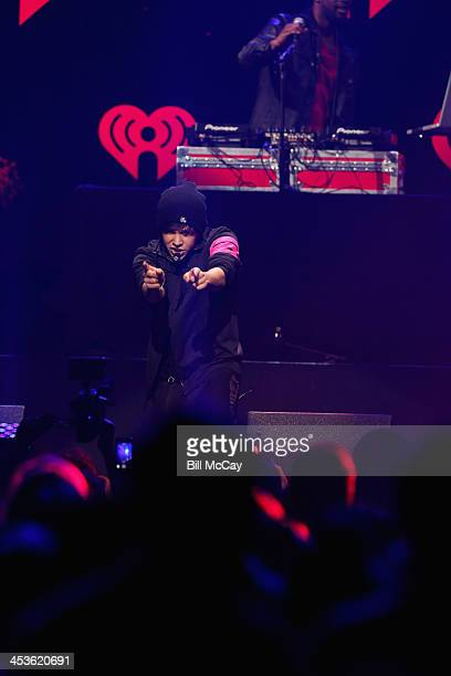 Singer Austin Mahone performs onstage during Q102's Jingle Ball 2013 presented by Bernie Robbins Jewelers at Wells Fargo Center on December 4 2013 in...