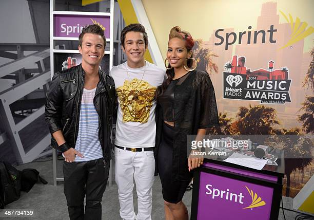 Singer Austin Mahone poses with radio personalities Nathan Fast and Nessa backstage at the 2014 iHeartRadio Music Awards held at The Shrine...