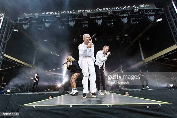 Singer Avriel Kaplan Kirstin Maldonado Mitchell Grassi Scott Hoying and Kevin Olusola of the American band Pentatonix perform live during a concert...