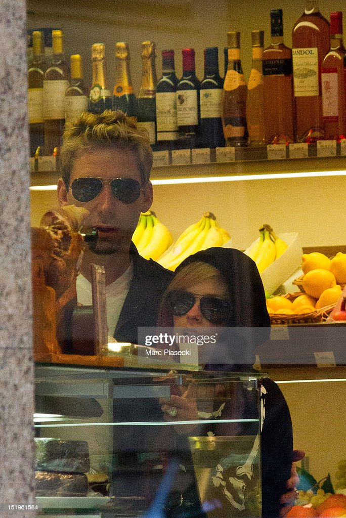 Singer Avril Lavigne and Chad Kroeger are seen at the 'Vignon' grocery store on September 13, 2012 in Paris, France.
