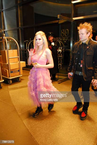 Singer Avril Lavigne and husband Deryck Whibley attend a tribute to the cofounder and chairman of Atlantic Records Ahmet Ertegun at the Time Warner...
