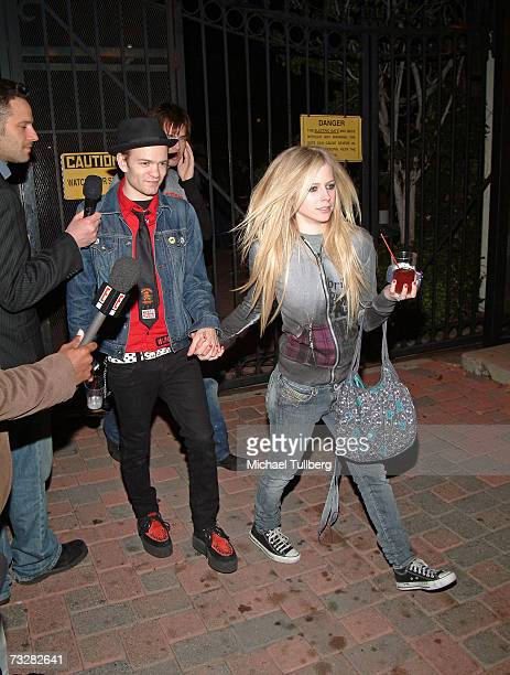 Singer Avril Lavigne and husband Deryck Whibley exit the 10th annual Friends And Family Grammy event held at the Jim Henson studios on February 9...