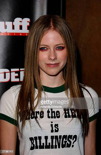 Singer Avril Lavigne arrives at the Kid Rock AfterParty for the American Music Awards at Forbidden City on November 16 2003 in Hollywood California...
