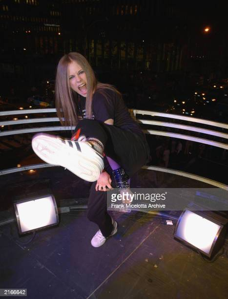 Singer Avril Lavigne kicking while rehearsing for the 2002 MTV Video Music Awards on the marquee overlooking Avenue of the Americas at Radio City...