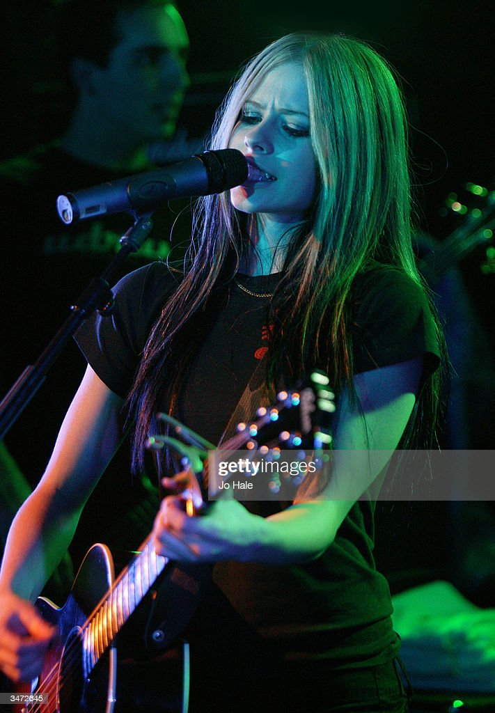Singer Avril Lavigne performs on stage during her secret fan club gig at the Camden Monarch on April 27, 2004 in London. The 19-year-old Canadian star, who has sold 14 million albums, releases her new single 'Don't Tell Me' on May 10 and her second album 'Under My Skin' on May 24.