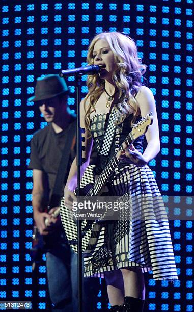 Singer Avril Lavigne performs on stage during the 2004 World Music Awards at the Thomas and Mack Center on September 15 2004 in Las Vegas Nevada...
