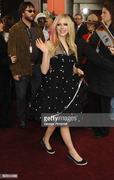 Singer Avril Lavigne poses on the red carpet at the 2008 Juno Awards at the Pengrowth Saddledome April 6 2008 in Calgary Alberta Canada