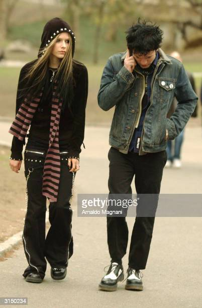 Singer Avril Lavigne walks with musician Deryck Whibley of Sum 41 in Central Park March 28 2004 in New York City