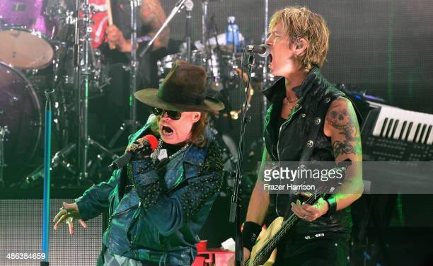 Singer Axl Rose and bassist Duff McKagan perform onstage at the 2014 Revolver Golden Gods Awards at Club Nokia on April 23 2014 in Los Angeles...
