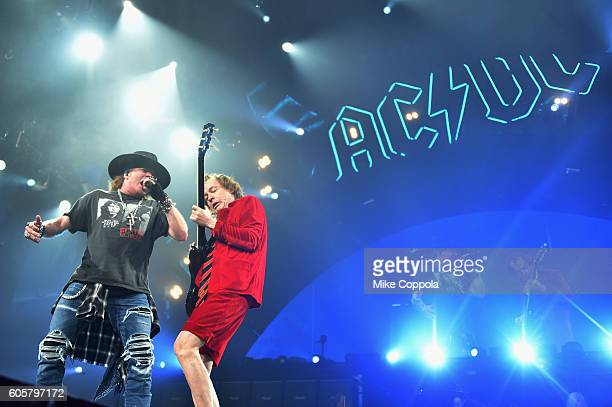 Singer Axl Rose and guitarist Angus Young of AC/DC perform during the AC/DC Rock Or Bust Tour at Madison Square Garden on September 14, 2016 in New...