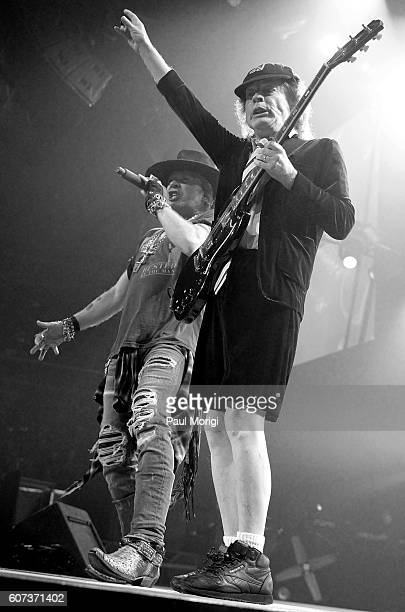 Singer Axl Rose and guitarist Angus Young of AC/DC perform during the AC/DC Rock or Bust Tour Washington DC at the Verizon Center on September 17...