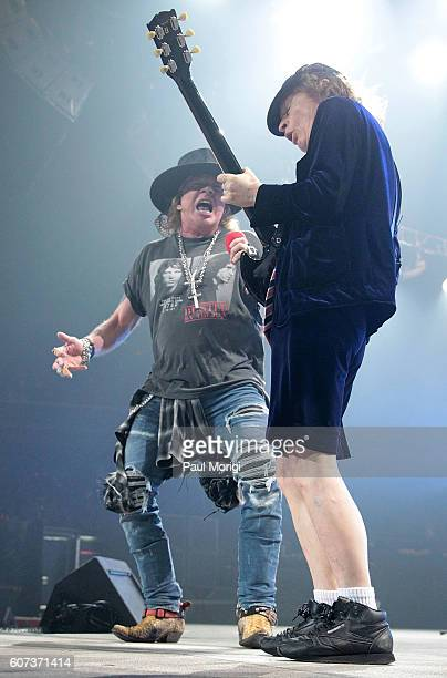 Singer Axl Rose and guitarist Angus Young of AC/DC perform during the during the AC/DC Rock or Bust Tour Washington DC at the Verizon Center on...