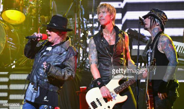 Singer Axl Rose bassist Duff McKagan and guitarist DJ Ashba perform onstage at the 2014 Revolver Golden Gods Awards at Club Nokia on April 23 2014 in...