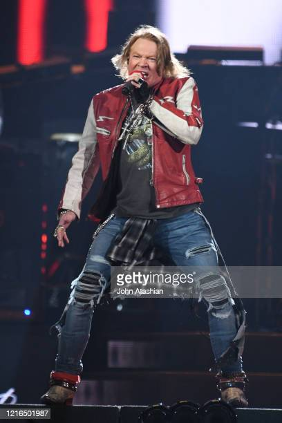 """Singer Axl Rose is shown performing on stage during a during a """"live"""" concert appearance with Guns N' Roses on October 23, 2017."""
