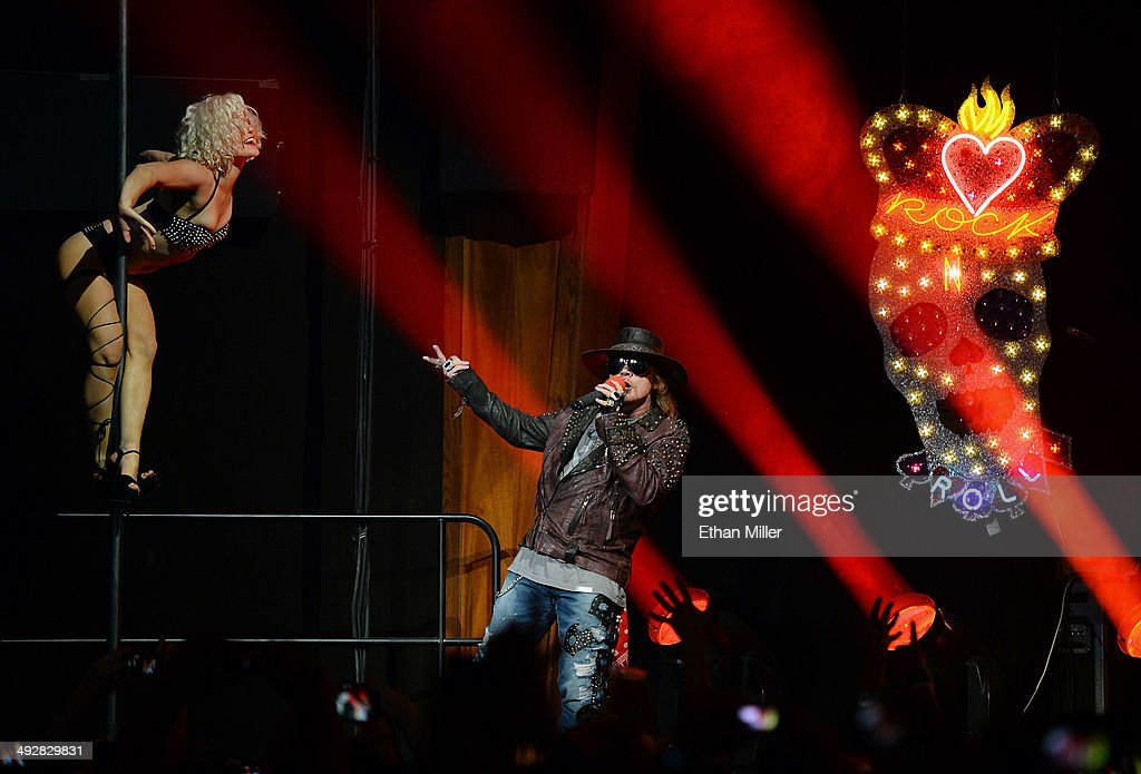 Singer Axl Rose of Guns N' Roses performs with a dancer at The Joint inside the Hard Rock Hotel & Casino during the opening night of the band's second residency, 'Guns N' Roses - An Evening of Destruction. No Trickery!' on May 21, 2014 in Las Vegas, Nevada.