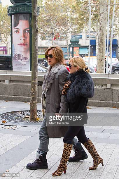 Singer Ayumi Hamasaki and boyfriend Maro are seen strolling on the 'Avenue des ChampsElysees' on November 16 2012 in Paris France