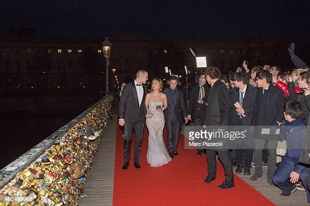 Singer Ayumi Hamasaki and her boyfriend attend the 'Buddha 2' Paris Premiere at the 'Pont des Arts' Bridge on January 27 2014 in Paris France