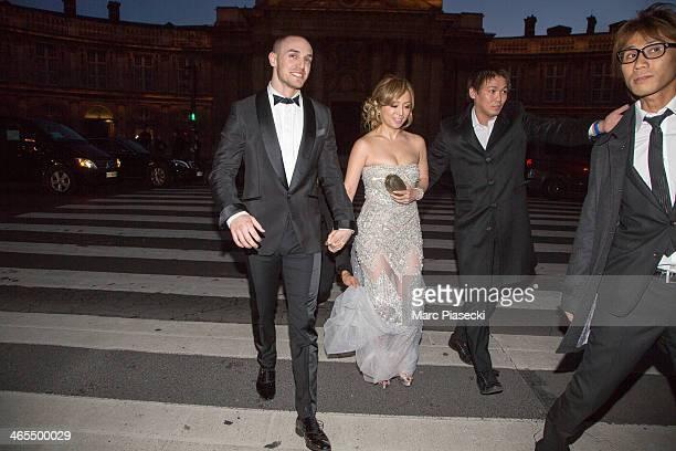 Singer Ayumi Hamasaki and her boyfriend attend the 'Buddha 2' Paris Premiere at the 'Pont des Arts' Bridge on January 27 2014 in Paris France