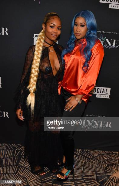 Singer Azia and That Girl Jay attend 2018 BET Social Awards Dinner at TWELVE Atlantic Station on March 02 2019 in Atlanta Georgia