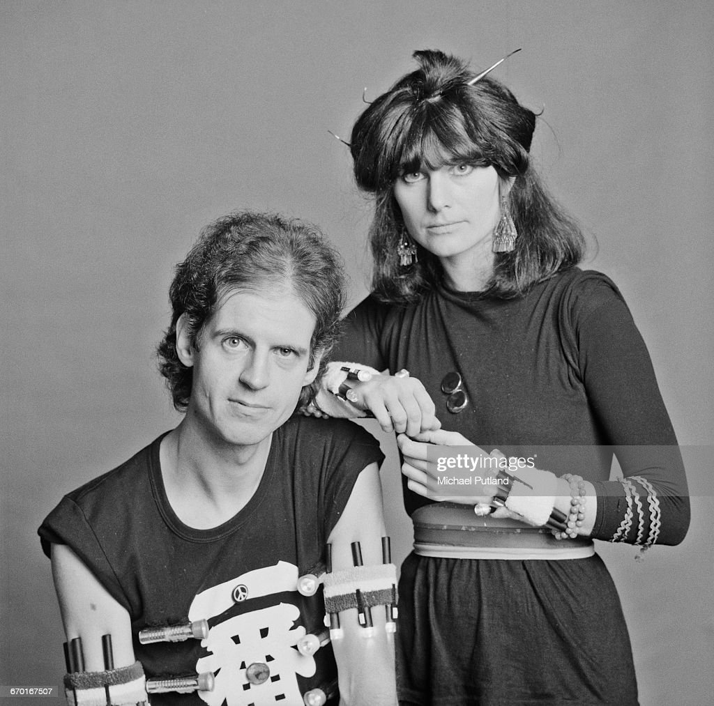 Singer Barbara Gaskin and keyboard player Dave Stewart, London, 1982. Both are wearing several torches strapped to their arms and wrists.