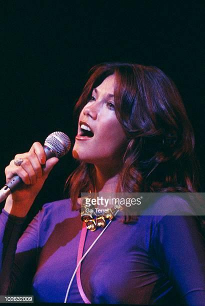 Singer Barbi Benton performs on stage circa 1975