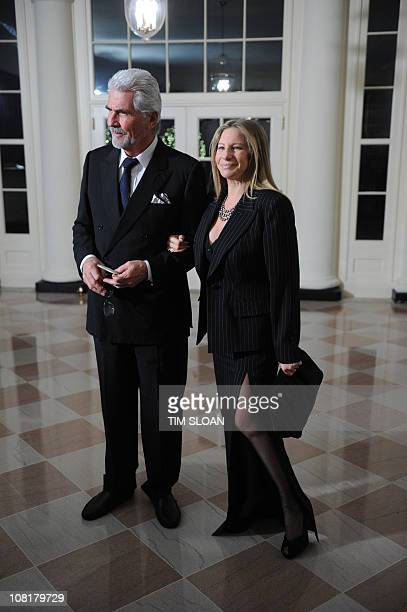 Singer Barbra Streisand and her husband actor James Brolin arrive for the State Dinner in honor of Chinese President Hu on January 19 2011 at the...