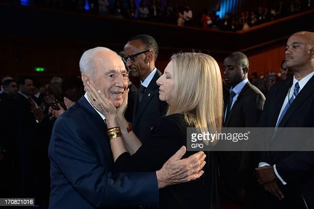 Singer Barbra Streisand hugs Israeli President Shimon Peres attend Peres' 90th birthday gala June 18, 2013 in Jerusalem, Israel. The celebration also...