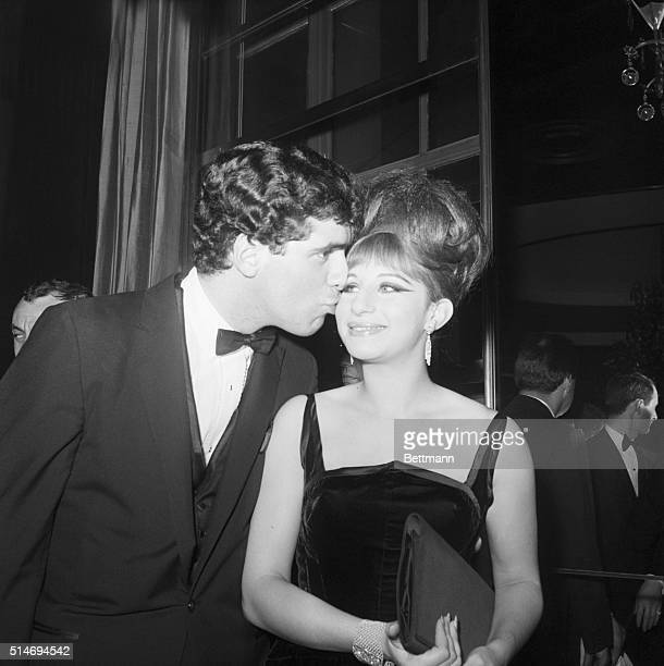 Singer Barbra Streisand receives a kiss from her husband Elliott Gould at a celebration party for the cast of Funny Girl at the Rainbow Room in New...