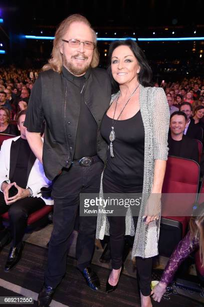 """Singer Barry Gibb and Linda Gray attend """"Stayin' Alive: A GRAMMY Salute To The Music Of The Bee Gees"""" on February 14, 2017 in Los Angeles, California."""