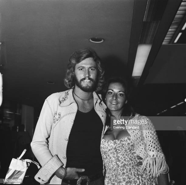 Singer Barry Gibb of pop group the Bee Gees at Heathrow Airport in London with his wife Linda , UK, 21st July 1973.