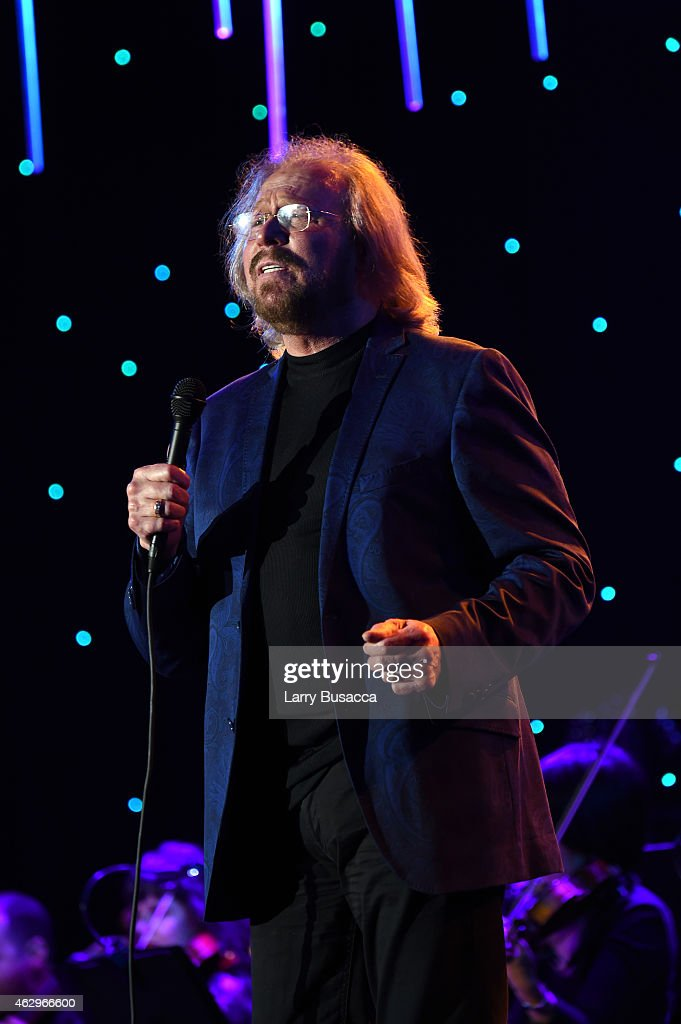 Singer Barry Gibb of The Bee Gees performs onstage during the Pre-GRAMMY Gala and Salute To Industry Icons honoring Martin Bandier at The Beverly Hilton Hotel on February 7, 2015 in Beverly Hills, California.