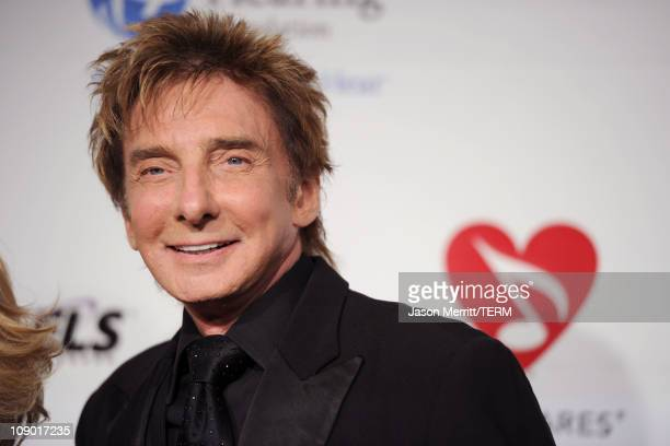 Singer Barry Manilow arrives at the 2011 MusiCares Person of the Year Tribute to Barbra Streisand held at the Los Angeles Convention Center on...
