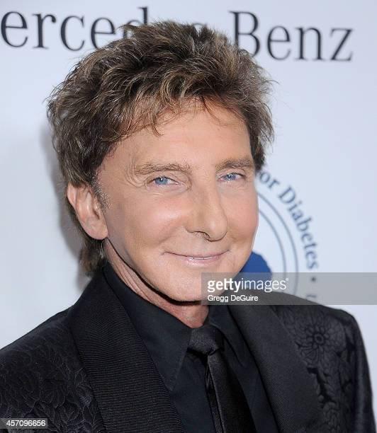 Singer Barry Manilow arrives at the 2014 Carousel Of Hope Ball Presented By MercedesBenz at The Beverly Hilton Hotel on October 11 2014 in Beverly...