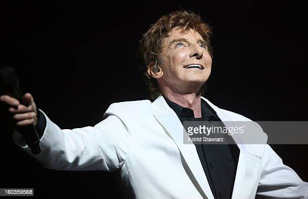 Singer Barry Manilow peforms during the curtain call of Manilow On Broadway Opening Night at the St James Theatre on January 29 2013 in New York City