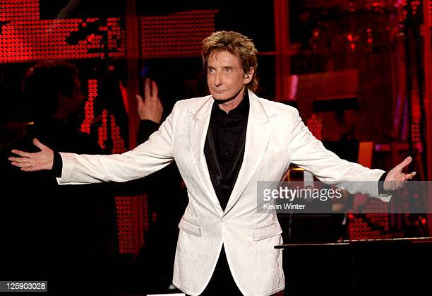 Singer Barry Manilow performs onstage at 2011 MusiCares Person of the Year Tribute to Barbra Streisand at Los Angeles Convention Center on February...