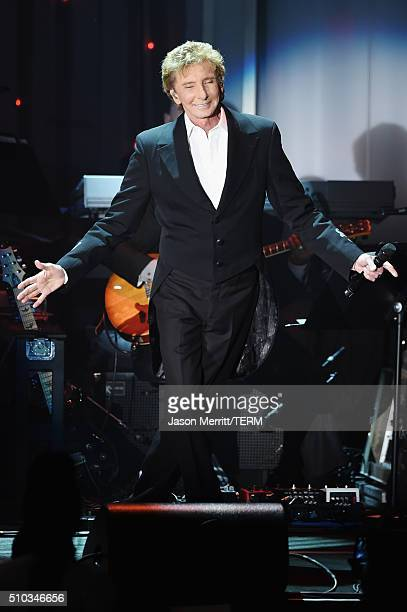 Singer Barry Manilow performs onstage during the 2016 PreGRAMMY Gala and Salute to Industry Icons honoring Irving Azoff at The Beverly Hilton Hotel...