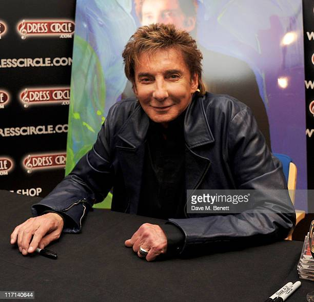 Singer Barry Manilow signs copies of his new album '15 Minutes' at Dress Circle Records on June 23 2011 in London England