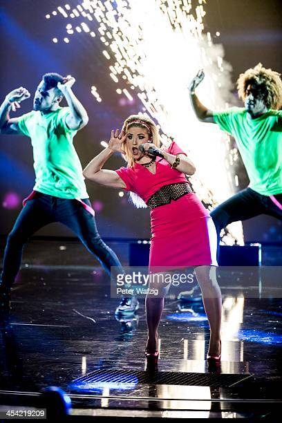 Singer Beatrice Egli performs as a show act during the second Semifinal of 'Das Supertalent' TV Show on December 07 2013 in Cologne Germany