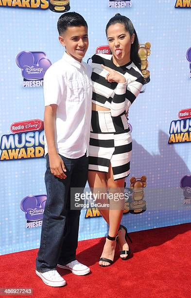 Singer Becky G and brother arrive at the 2014 Radio Disney Music Awards at Nokia Theatre LA Live on April 26 2014 in Los Angeles California