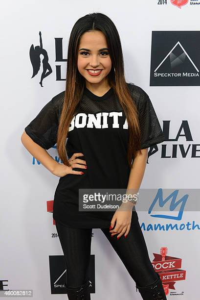 Singer Becky G poses on the red carpet at LA LIVE for the 5th annual Rock the Red Kettle Concert hosted by the Salvation Army on December 6 2014 in...