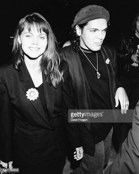 Singer Belinda Carlisle and her date attending a party at Kensington Roof Gardens London September 26th 1988