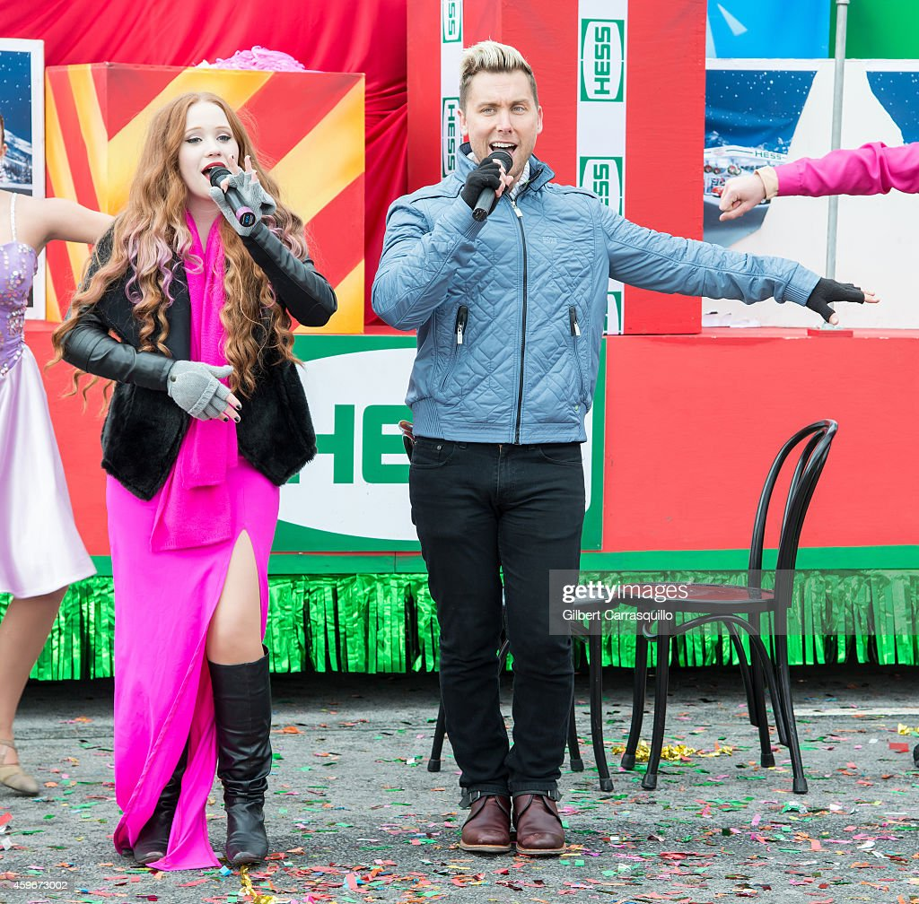Singer Bella Blue and Singer, dancer, actor, film and television producer, author Lance Bass perform during the 95th Annual 6abc Dunkin' Donuts Thanksgiving Day Parade on November 27, 2014 in Philadelphia, Pennsylvania.