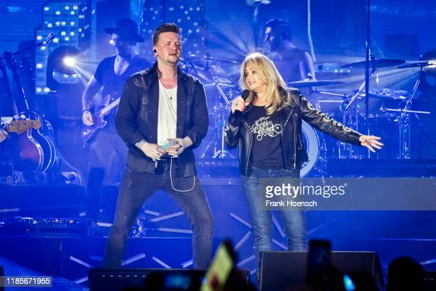 Singer Ben Zucker and Bonnie Tyler perform live on stage during a concert at the MercedesBenz Arena on November 30 2019 in Berlin Germany