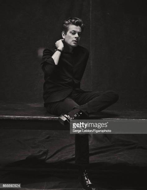 Singer Benjamin Biolay is photographed for Madame Figaro on July 23 2017 in Paris France Shirt and jeans boots bracelet personal PUBLISHED IMAGE...