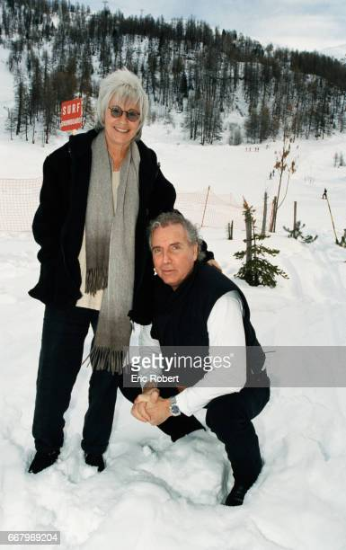 Singer Bernard Lavilliers stands in the snow with singer and violinist Catherine Lara The two are at Club Med in Val d'Isere for a radio promotion...