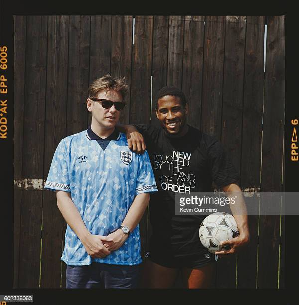 Singer Bernard Sumner of English rock group New Order with footballer John Barnes during the video shoot for the official song of the England...
