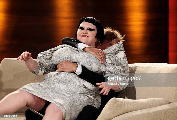 Singer Beth Ditto sits down on Hansi Hinterseer during the 188th 'Wetten dass ' show at Messezentrum Salzburg on March 27 2010 in Salzburg Austria