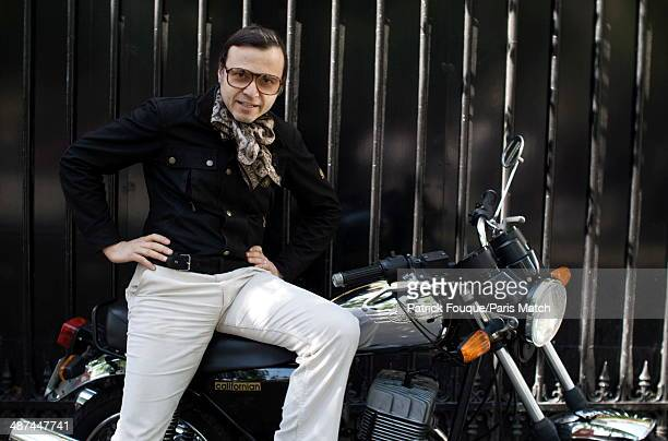 Singer Betrand Burgalat is photographed for Paris Match riding his favorite motocycle a Jawa on May 14 2012 in ParisFrance